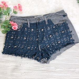 Free people embellished lace cutoff frayed shorts